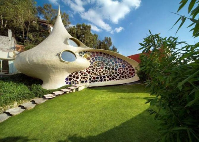 Nedidelis, unikalaus dizaino sraigės namelis