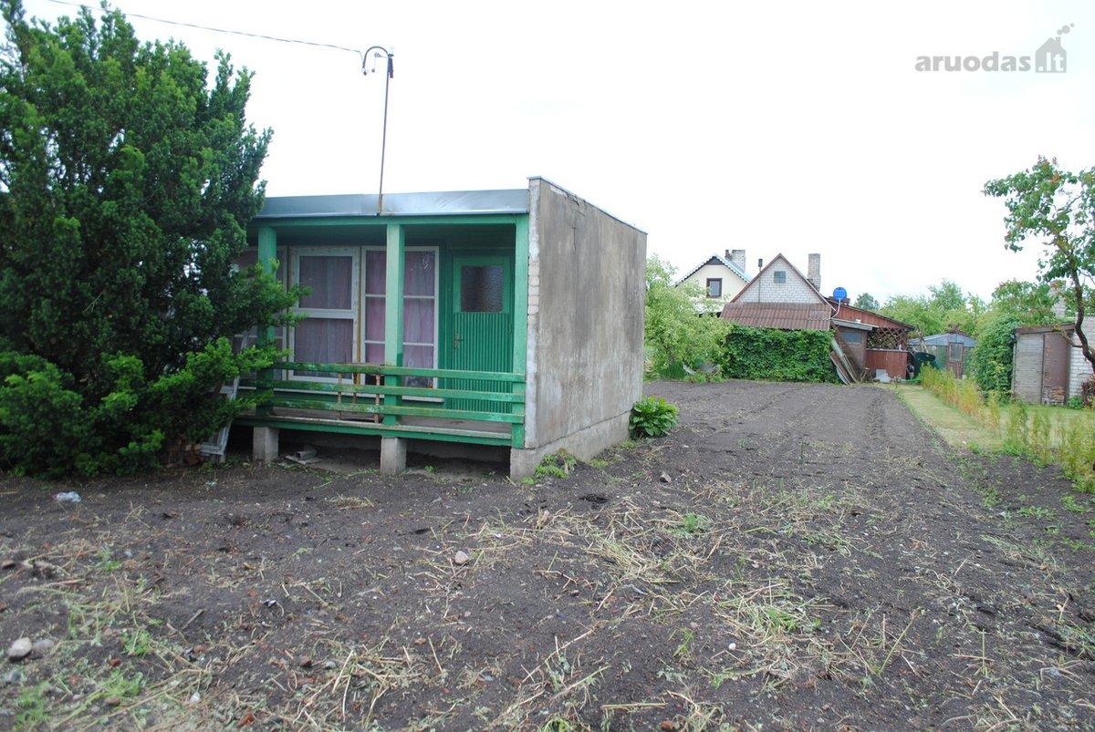 Raseinių m., Rožių g., medinis sodo namas