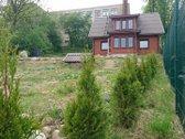 Namas yra Molėtuose prie pat ežero,