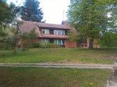 Parduodamas poilsio namas su žemės sklypu