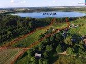 Parduodama sodyba prie ežero su 2,27 ha žemės