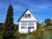 Parduodamas 6 arų žemės sklypas su sodo namu