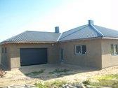 Parduodamas nebaigtos statybos namas