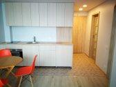 - Virtuvėje: integruoti virtuvės baldai,